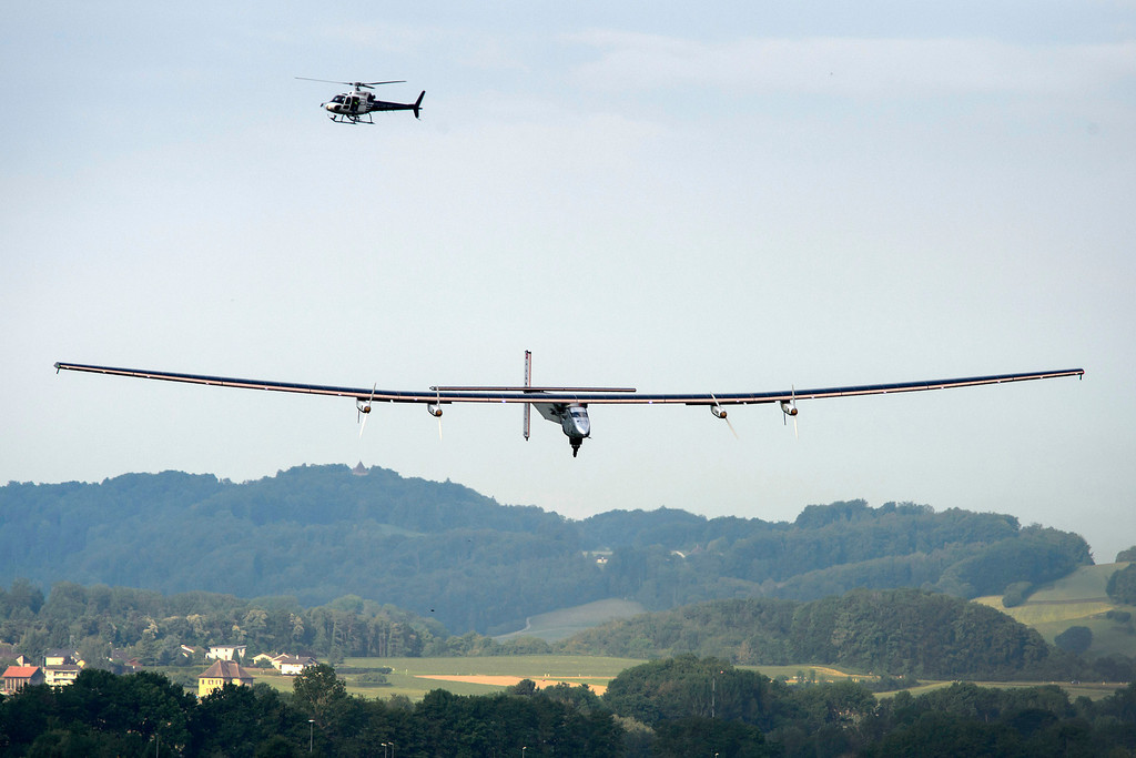 . German test pilot Markus Scherdel lands the solar-powered Solar Impulse 2 aircraft after its first flight Monday, June 2, 2014 in Payerne, Switzerland.  (AP Photo/Fabrice Coffrini, pool)