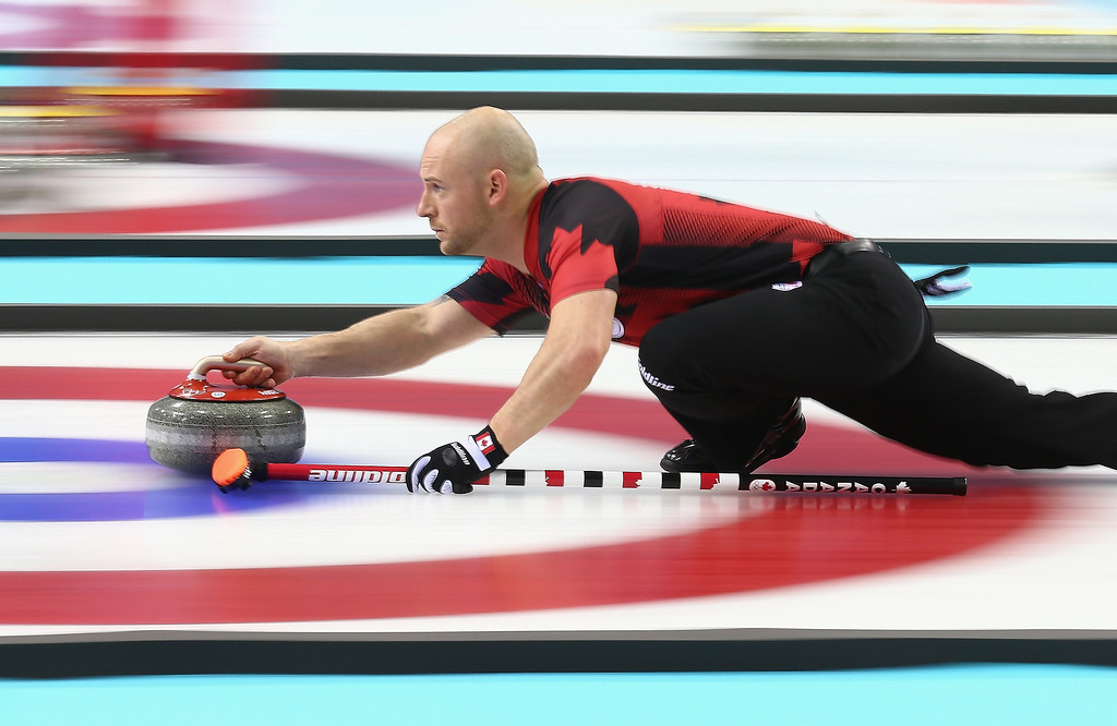 . Ryan Fry of Canada in action during the round robin match against Switzerland during day 3 of the Sochi 2014 Winter Olympics at Ice Cube Curling Center on February 10, 2014 in Sochi, Russia.  (Photo by Clive Mason/Getty Images)