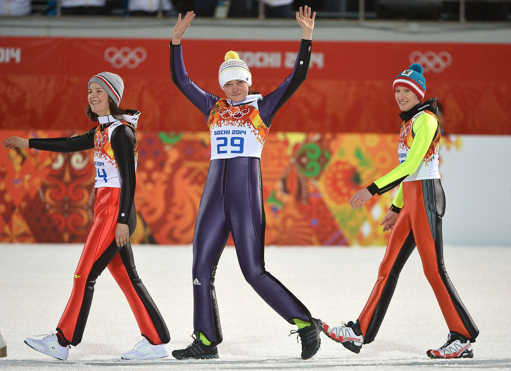 . Bronze medalist France\'s Coline Mattel, gold medalist Germany\'s Carina Vogt and silver medalist Austria\'s Daniela Iraschko-Stolz celebrates during the Women\'s Ski Jumping Normal Hill Individual Flower Ceremony at the RusSki Gorki Jumping Center during the Sochi Winter Olympics on February 11, 2014 in Rosa Khutor near Sochi.  ALBERTO PIZZOLI/AFP/Getty Images