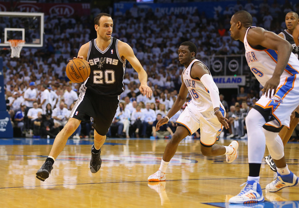 . OKLAHOMA CITY, OK - MAY 31:  Manu Ginobili #20 of the San Antonio Spurs drives with the ball against the Oklahoma City Thunder in the first half during Game Six of the Western Conference Finals of the 2014 NBA Playoffs at Chesapeake Energy Arena on May 31, 2014 in Oklahoma City, Oklahoma. (Photo by Ronald Martinez/Getty Images)