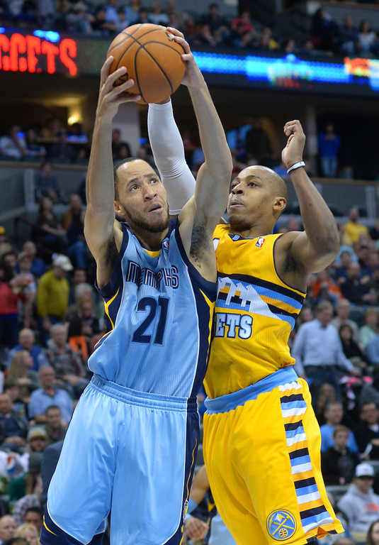 . DENVER, CO. - JANUARY 03:  Denver guard Randy Foye (4) challenged Memphis forward Tayshaun Prince (21) in the second half. The Denver Nuggets broke an eight-game losing streak with a 111-108 win over the Memphis Grizzlies at the Pepsi Center Friday night, January 3, 2014. Photo By Karl Gehring/The Denver Post