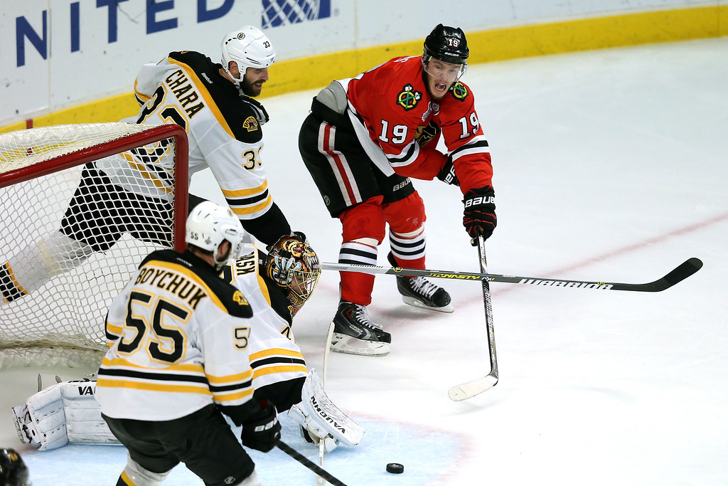 . CHICAGO, IL - JUNE 22:  Jonathan Toews #19 of the Chicago Blackhawks attempts a wrap around shot on goal against goalie Tuukka Rask #40 of the Boston Bruins in Game Five of the 2013 NHL Stanley Cup Final at United Center on June 22, 2013 in Chicago, Illinois.  (Photo by Jonathan Daniel/Getty Images)