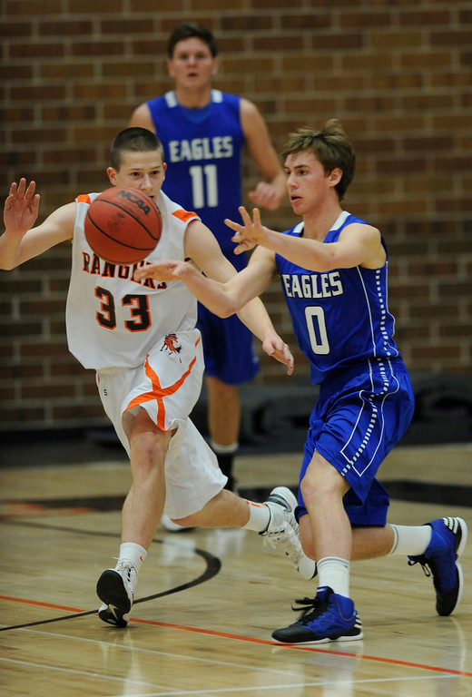 . Eagles guard Chad Jukkala (0) worked the ball past Rangers guard Chase Stone (33) in the first half. The Lewis-Palmer High School boy\'s basketball team defeated Broomfield 75-53 Friday night, December 7, 2012.  Karl Gehring/The Denver Post