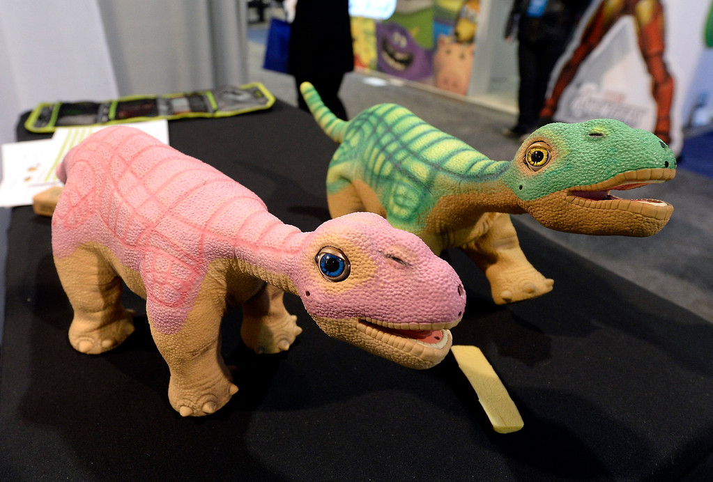 . NNVO labs toy dinosaur robots are displayed at the 2014 International CES (Consumer Electronics Show) in Las Vegas, Nevada, USA, 08 January 2014. CES, the world\'s largest annual consumer technology trade show, runs from 7-10 January and is expected to feature 3,200 exhibitors displaying their latest products and services to about 150,000 attendees.  EPA/MICHAEL NELSON