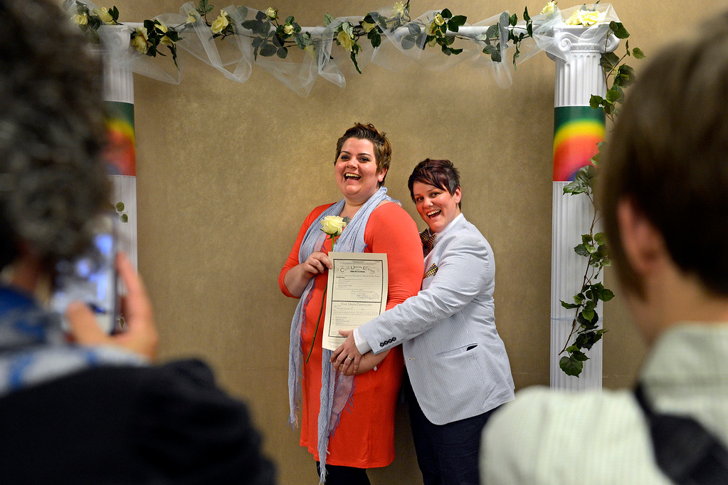 ". Andie Lyons, left, and her partner, Laurie Lynch, have their photo taken after receiving their civil-union license at the Clerk and Recorder\'s office. Although civil unions grant couples most of the same legal rights as marriage, Colorado voters banned same-sex marriages by approving a constitutional amendment in 2006. Denver Mayor Michael Hancock said it\'s time for that to change: ""We will not stop until our state residents ... have full marriage equality under the law.\"""