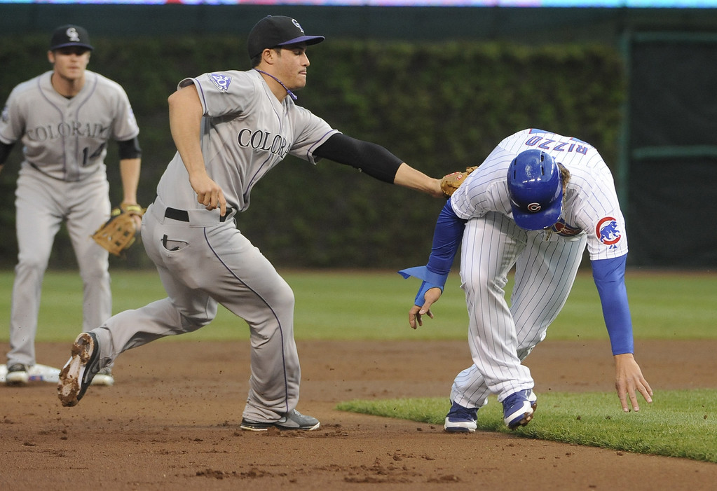 . Anthony Rizzo #44 of the Chicago Cubs is picked off and tagged by Nolan Arenado #28 of the Colorado Rockies during the first inning on May 15, 2013 at Wrigley Field in Chicago, Illinois.   (Photo by David Banks/Getty Images)