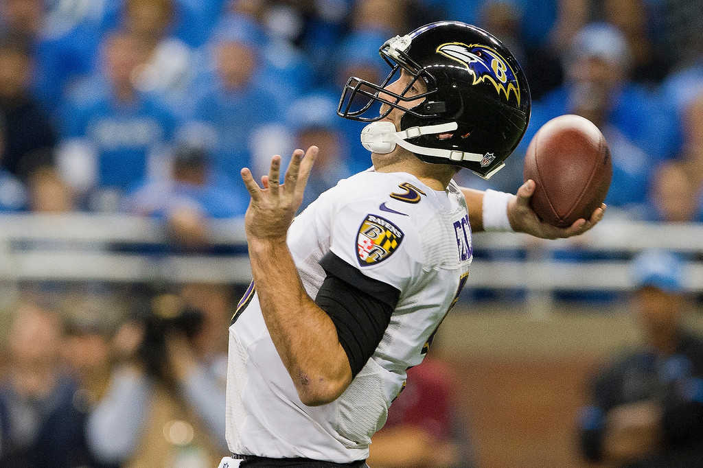 . Quarterback Joe Flacco #5 of the Baltimore Ravens passes during the first half against the Detroit Lions at Ford Field on December 16, 2013 in Detroit, Michigan. (Photo by Jason Miller/Getty Images)