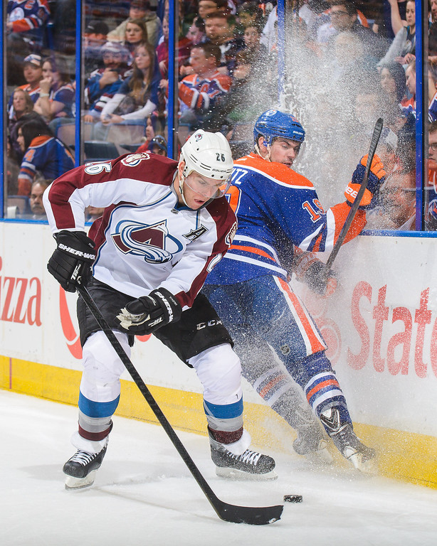 . Justin Schultz #19 of the Edmonton Oilers misses a check on Paul Stastny #26 of the Colorado Avalanche during an NHL game at Rexall Place on April 8, 2014 in Edmonton, Alberta, Canada. The Avalanche defeated the Oilers 4-1. (Photo by Derek Leung/Getty Images)