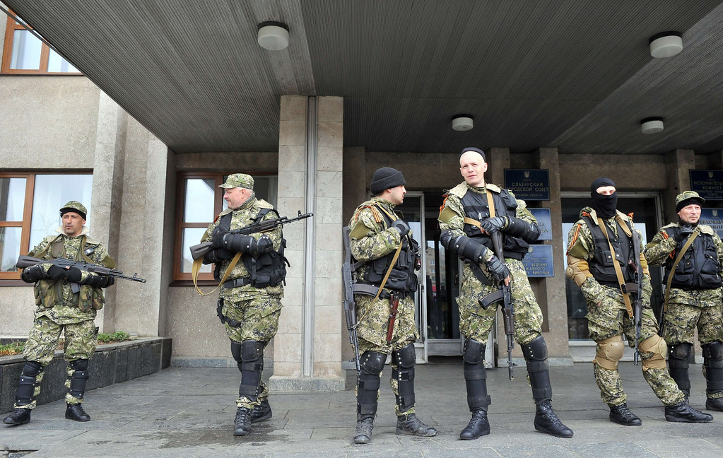 . Armed men in military fatigues stand guard outside a regional administration building they seized in the eastern Ukrainian city of Slavyansk on April 14, 2014.  AFP PHOTO / GENYA  SAVILOV/AFP/Getty Images