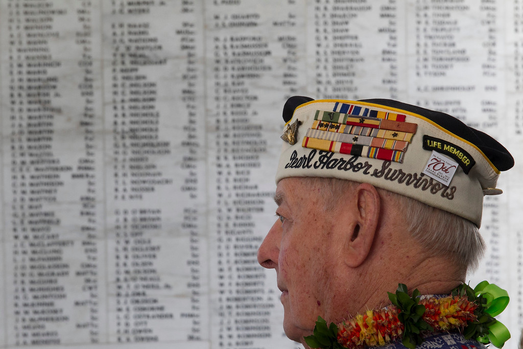 . Pearl Harbor survivor Lou Contor stands in the memorial room aboard the USS Arizona Memorial during the ceremony commemorating the 72nd anniversary of the attack on Pearl Harbor, Saturday, Dec. 7, 2013, in Honolulu.  (AP Photo/Marco Garcia)