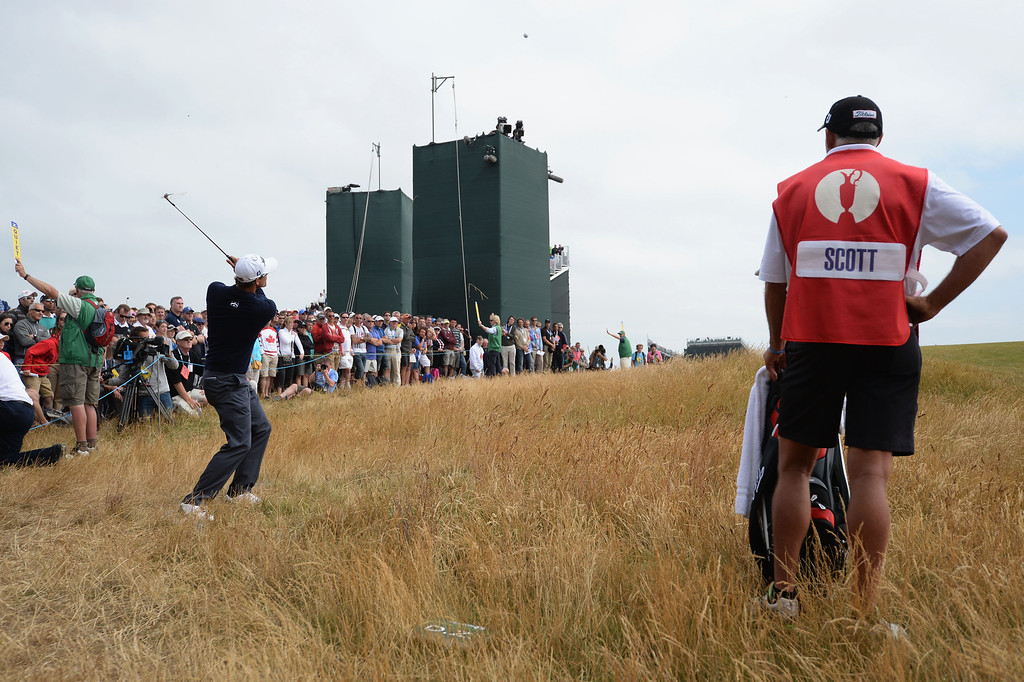 . Adam Scott of Australia attempts to chip on the green during the final round of the 142nd Open Championship at Muirfield on July 21, 2013 in Gullane, Scotland.  (Photo by Stuart Franklin/Getty Images)