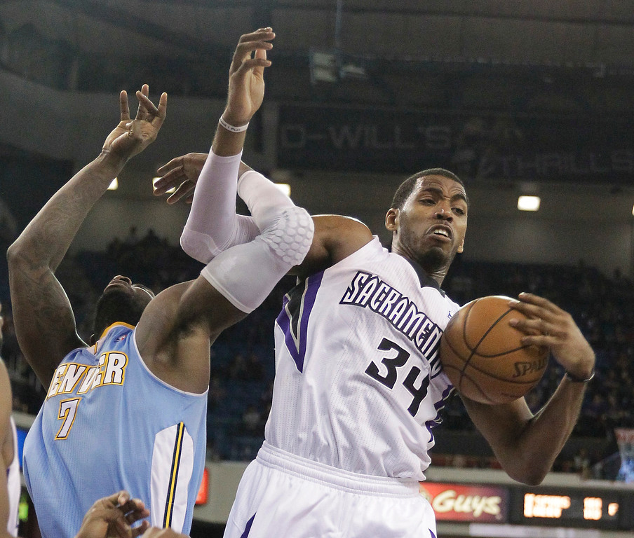 . Sacramento Kings forward Jason Thompson, right, pulls a rebound away from Denver Nuggets J.J. Hickson during the third quarter of an NBA basketball game in Sacramento, Calif., Sunday, Jan. 26, 2014. The Nuggets won 125-117.(AP Photo/Rich Pedroncelli)