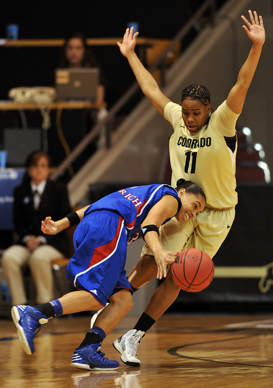 . BOULDER, CO. - MARCH 23: Brittany Wilson of Colorado Buffaloes (11) is defending against Angel Goodrich of Kansas Jayhawks (3) during the first round of the 2013 NCAA women\'s Basketball Tournament at Coors Events Center. Boulder, Colorado. March 23, 2013. (Photo By Hyoung Chang/The Denver Post)