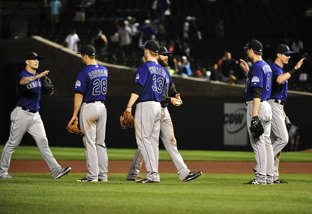 . CHICAGO, IL - JULY 30:   The Colorado Rockies celebrate their win against the Chicago Cubs on July 30, 2014 at Wrigley Field in Chicago, Illinois. The Colorado Rockies defeated the Chicago Cubs 6-4. (Photo by David Banks/Getty Images)
