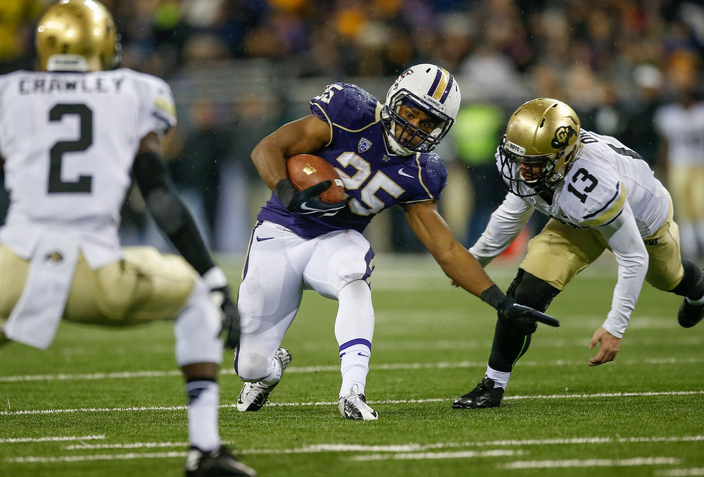 . Running back Bishop Sankey #25 of the Washington Huskies rushes against the Colorado Buffaloes on November 9, 2013 at Husky Stadium in Seattle, Washington.  (Photo by Otto Greule Jr/Getty Images)
