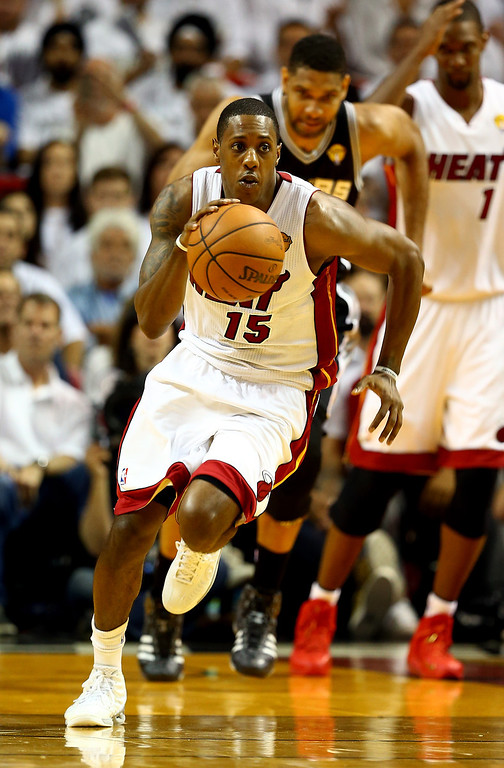 . MIAMI, FL - JUNE 10:  Mario Chalmers #15 of the Miami Heat brings the ball up the floor against the San Antonio Spurs during Game Three of the 2014 NBA Finals at American Airlines Arena on June 10, 2014 in Miami, Florida.  (Photo by Andy Lyons/Getty Images)