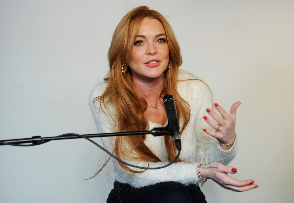 ". Actress Lindsay Lohan addresses reporters at a news conference at the 2014 Sundance Film Festival, Monday, Jan. 20, 2014, in Park City, Utah. Producer Randall Emmett and Lohan announced the forthcoming production of a new film, ""Inconceivable,\"" in which Lohan will star and co-produce. (Photo by Chris Pizzello/Invision/AP)"