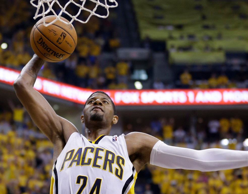 . Indiana Pacers forward Paul George dunks against the Miami Heat during the second half of Game 5 of the NBA basketball Eastern Conference finals in Indianapolis, Wednesday, May 28, 2014. (AP Photo/Michael Conroy)