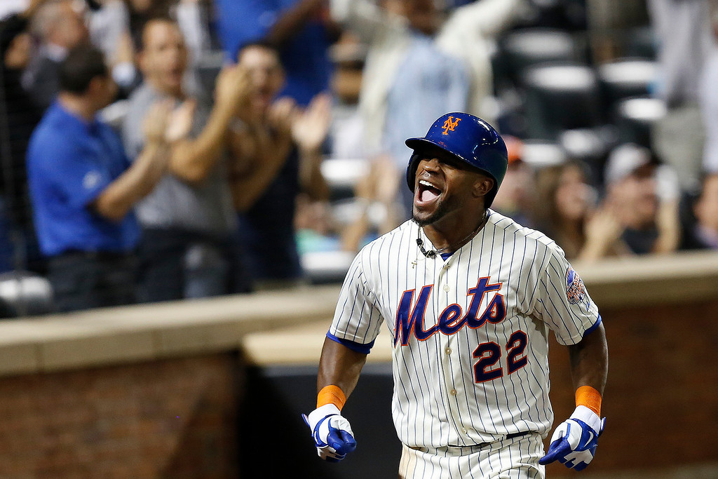 . New York Mets\' Eric Young Jr. celebrates after scoring a run in the eighth inning of a baseball game against the Colorado Rockies at Citi Field, Tuesday, Aug. 6, 2013, in New York. (AP Photo/John Minchillo)