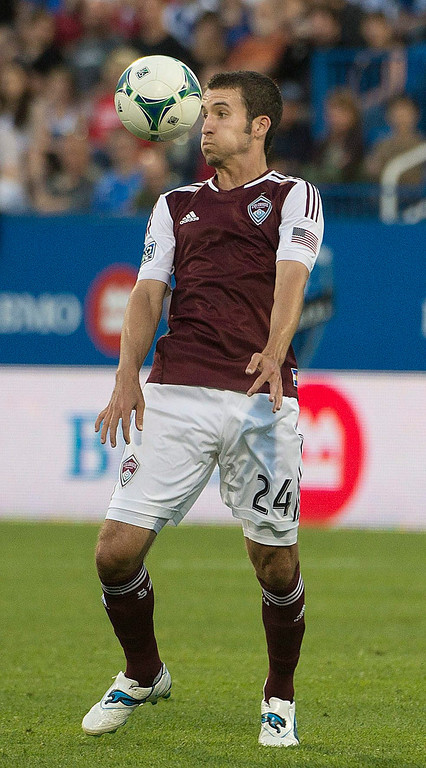 . Colorado Rapids\' Nathan Sturgis tries to control the ball during the second half of an MLS soccer game against the Montreal Impace in Montreal on Saturday, June 29, 2013. (AP Photo/The Canadian Press, Peter McCabe)
