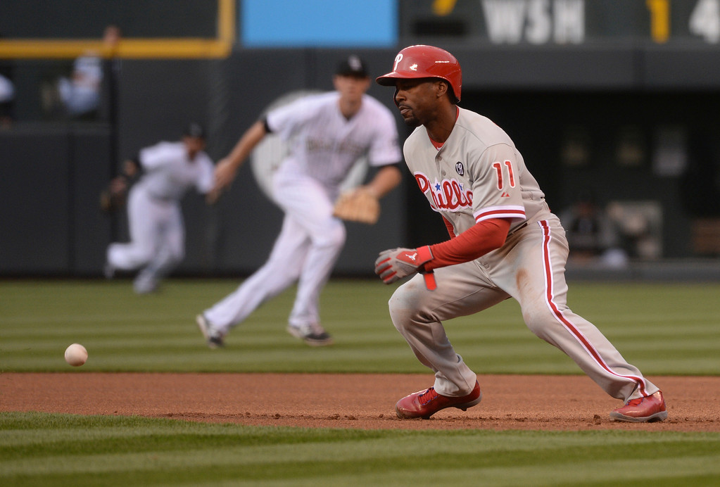 . DENVER, CO - APRIL 18: Philadelphia baserunner Jimmy Rollins (11) had to hold up as a ball off the bat of teammate Ryan Howard cut across the grass in front of him in the first inning. Howard grounded out to end the top of the first inning. The Colorado Rockies hosted the Philadelphia Phillies Friday night, April 18, 2014 at Coors Field.  (Photo by Karl Gehring/The Denver Post)