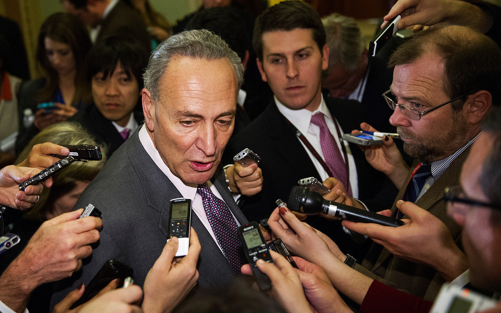 ". US Senator Charles Schumer (D-NY) talks with reporters in the halls of the US Senate late December 31, 2012 in Washington, DC after attending a Democrat Caucus on solving the impending fiscal cliff.  The White House and top Republicans struck a deal late December 31, 2012 to avert huge New Year tax hikes and spending cuts known as the ""fiscal cliff\"" that had threatened to send the US economy into recession.     PAUL J. RICHARDS/AFP/Getty Images"