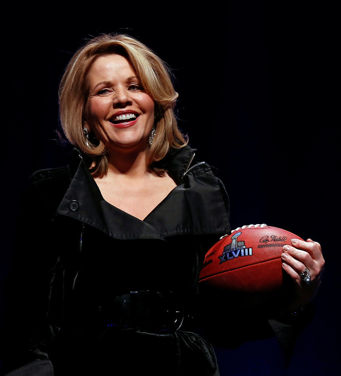 . Grammy award winning soprano, Renee Fleming, poses with a football at a news conference for the Super Bowl LXVIII in New York, New York, USA, 30 January 2014.   EPA/TANNEN MAURY