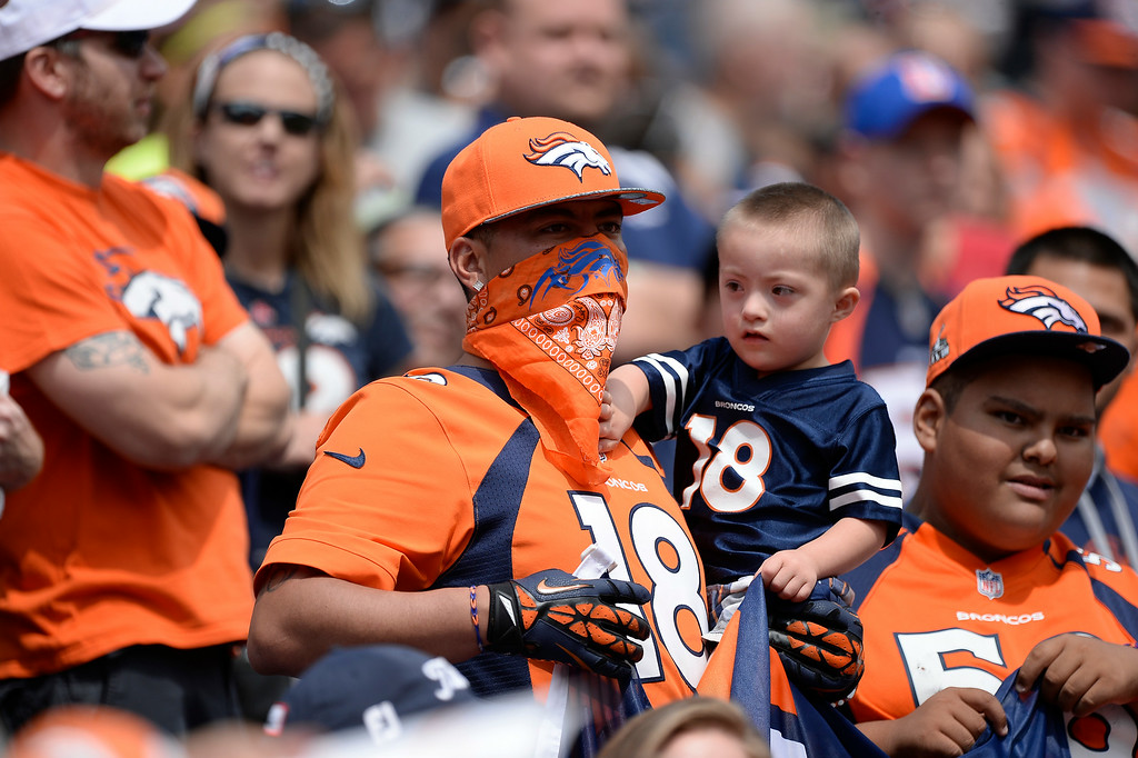 . Denver Broncos fans attend practice on day four of the Denver Broncos 2014 training camp July 27, 2014 at Sports Authority Field at Mile High. (Photo by John Leyba/The Denver Post)