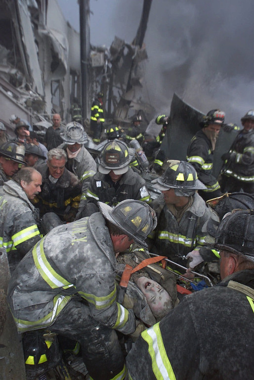 . A fireman screams in pain during his rescue shortly after both towers of New York\'s World Trade Center collapsed following a terrorist attack, Sept. 11, 2001.  (AP Photo/Robert Mecea, Newsday/FILE)