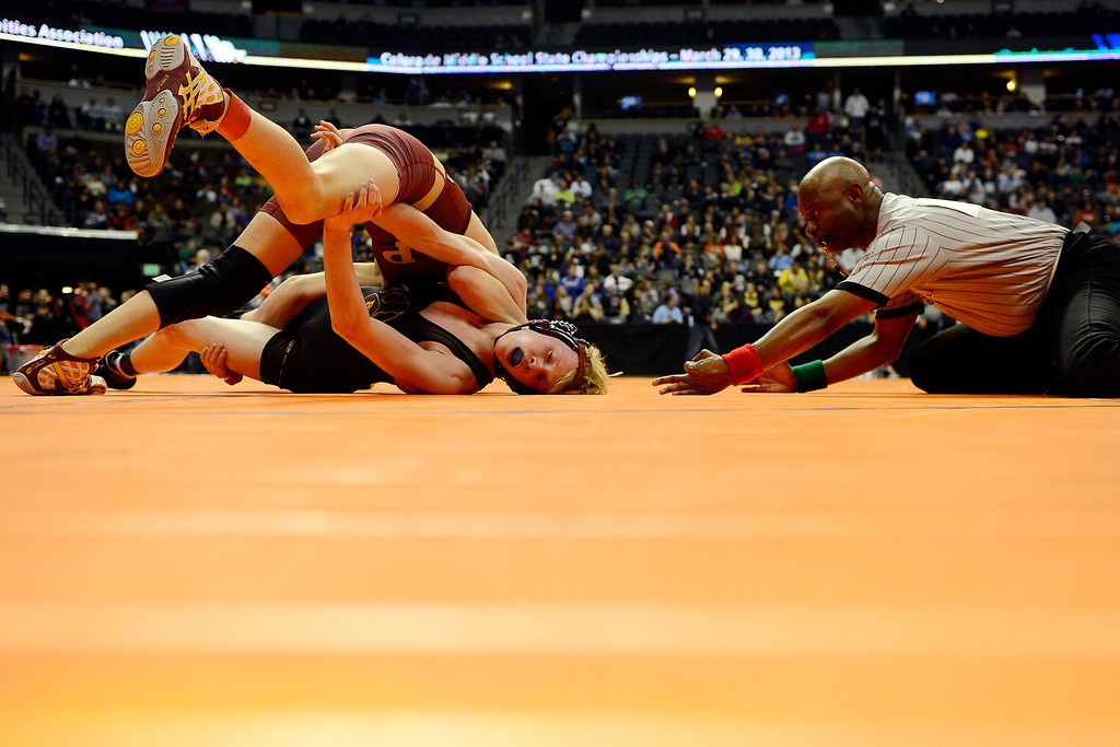 . DENVER, CO - FEBRUARY 21: Ponderosa 113-pounder Kade Snider controls Rocky Mountain\'s Logan Newman en route to a 19-1 technical fall win during the Colorado State High School Wrestling Championships. The state finals will run through Saturday evening at the Pepsi Center. (Photo by AAron Ontiveroz/The Denver Post)