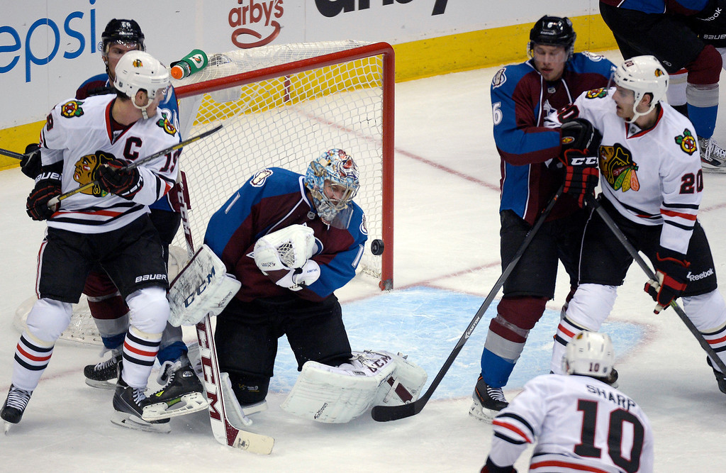 . Colorado Avalanche goalie Semyon Varlamov (1) makes a save on a shot by Chicago Blackhawks left wing Patrick Sharp (10) during the second period November 19, 2013 at Pepsi Center. (Photo by John Leyba/The Denver Post)