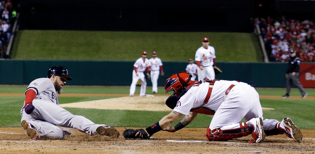 . St. Louis Cardinals catcher Yadier Molina tags out Boston Red Sox\'s David Ross at home during the seventh inning of Game 5 of baseball\'s World Series Monday, Oct. 28, 2013, in St. Louis. Ross tried to score from second on a hit by Jacoby Ellsbury. (AP Photo/David J. Phillip)