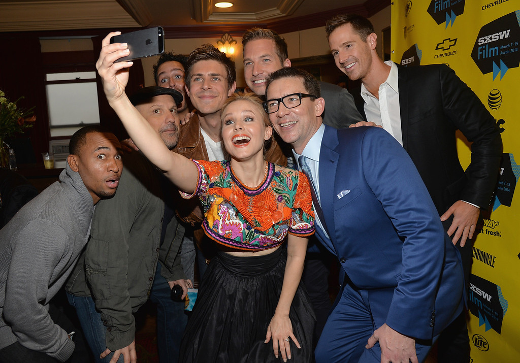 ". Actress Kristen Bell (C) poses for a selfie with cast members (L-R) Percy Daggs, Enrico Colantoni, Chris Lowell, Ryan Hansen, Jason Dohring and director Rob Thomas at the premiere of ""Veronica Mars\"" during the 2014 SXSW Music, Film + Interactive Festival at the Paramount Theatre on March 8, 2014 in Austin, Texas.  (Photo by Michael Buckner/Getty Images for SXSW)"