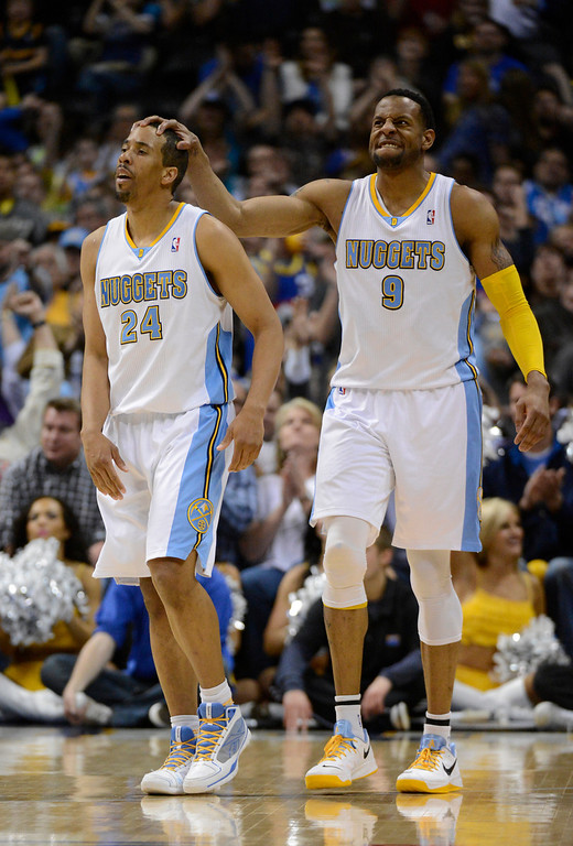 . DENVER, CO. - APRIL 04: Andre Iguodala (9) of the Denver Nuggets puts his hand on Andre Miller (24) of the Denver Nuggets head after scoring and getting fouled int he fourth quarter April 4,  2013 at Pepsi Center. The Denver Nuggets defeated the Dallas Mavericks 95-94. (Photo By John Leyba/The Denver Post)