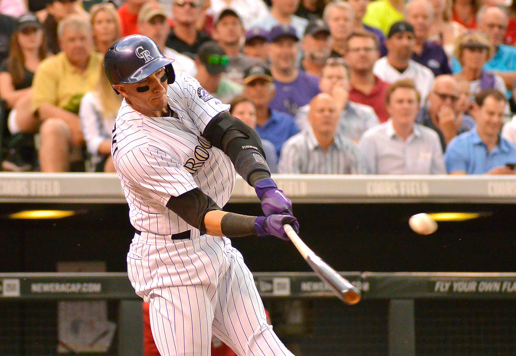 . DENVER, CO - JUNE 24: Colorado Rockies shortstop Troy Tulowitzki (2) singles to center field against the St. Louis Cardinals June 24, 2014 at Coors Field. (Photo by John Leyba/The Denver Post)
