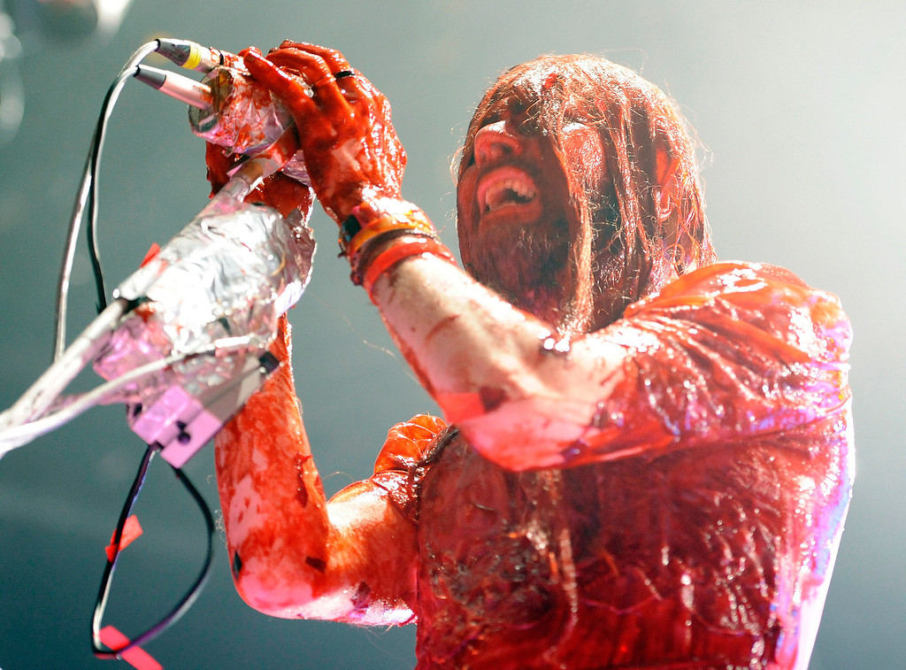 """. Wayne Coyne, of The Flaming Lips, performs during their \""""Halloween Blood Bath\"""" tour stop at The Greek Theatre, Tuesday, Oct. 29, 2013, in Los Angeles. (Photo by Chris Pizzello/Invision/AP)"""