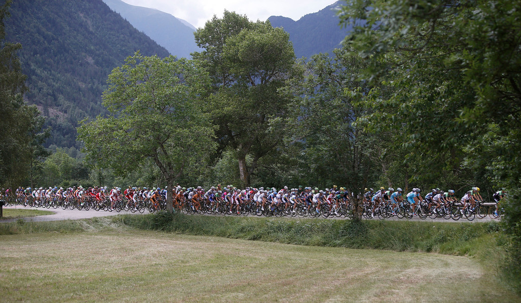 . The pack rides during the eighteenth stage of the Tour de France cycling race over 172.5 kilometers (107.8 miles) with start in Gap and finish in Alpe-d\'Huez, France, Thursday July 18, 2013. (AP Photo/Laurent Cipriani)