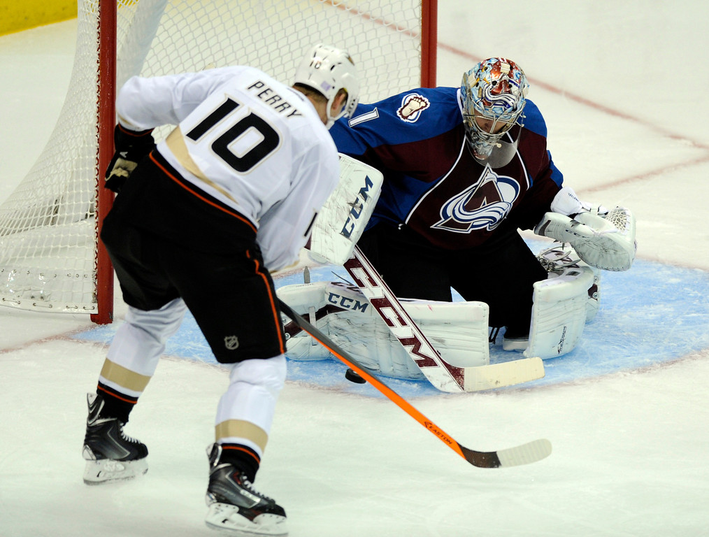 . DENVER, CO. - OCTOBER 02: Anaheim wing Corey Perry (10) tried to get his stick on the puck in front of Avalanche goaltender Semyon Varlamov (1) in the second period. The Colorado Avalanche hosted the Anaheim Ducks at the Pepsi Center Wednesday night, October 2, 2013. Photo By Karl Gehring/The Denver Post