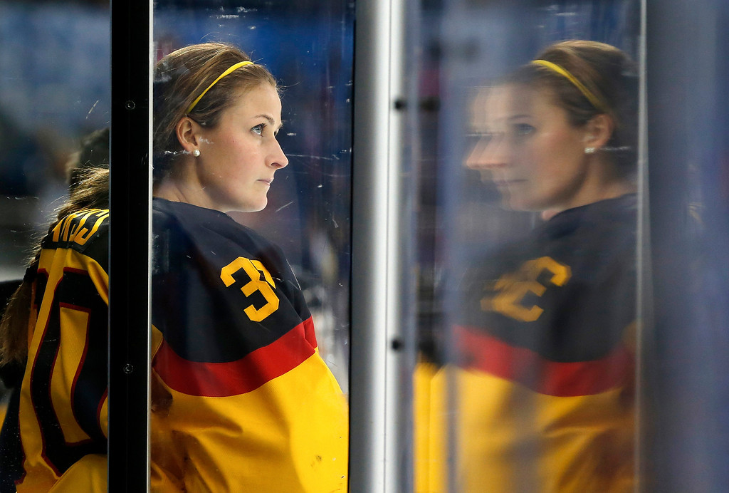. Goalkeeper Jennifer Harss of Germany watches the action against Russia from the bench during the 2014 Winter Olympics women\'s ice hockey game at Shayba Arena, Sunday, Feb. 9, 2014, in Sochi, Russia. (AP Photo/Petr David Josek)