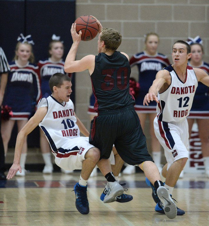 . LITTLETON, CO. - JANUARY 17: Eagles\' defender Cody Pittman (10) tried to draw a charge call on Chatfield\'s Darius Reiter (30) in the first half. The Dakota Ridge High School boy\'s basketball team hosted Chatfield Friday night, January 16, 2014. Photo By Karl Gehring/The Denver Post