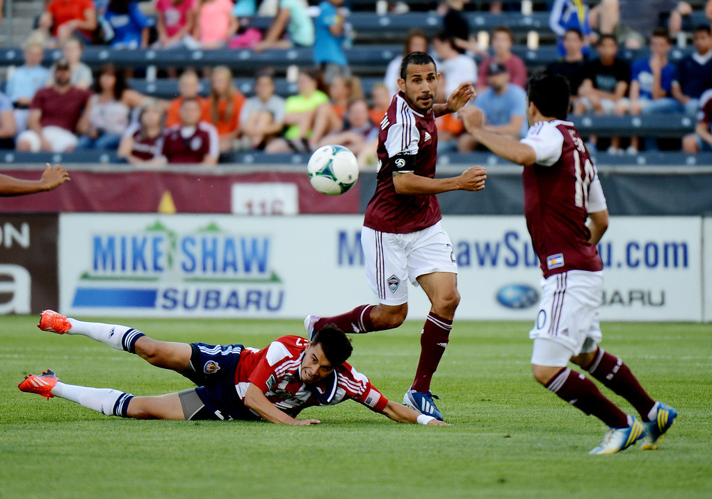 . COMMERCE CITY, CO. - MAY 25: Pablo Mastroeni of Colorado Rapids (25) steals the ball from Carlos Alvarez of Chivas USA (20), bottom, by Martin Rivero of Colorado (10) in the 1st half of the game at Dick\'s Sporting Goods Park. Commerce City, Colorado. May 25, 2013. (Photo By Hyoung Chang/The Denver Post)