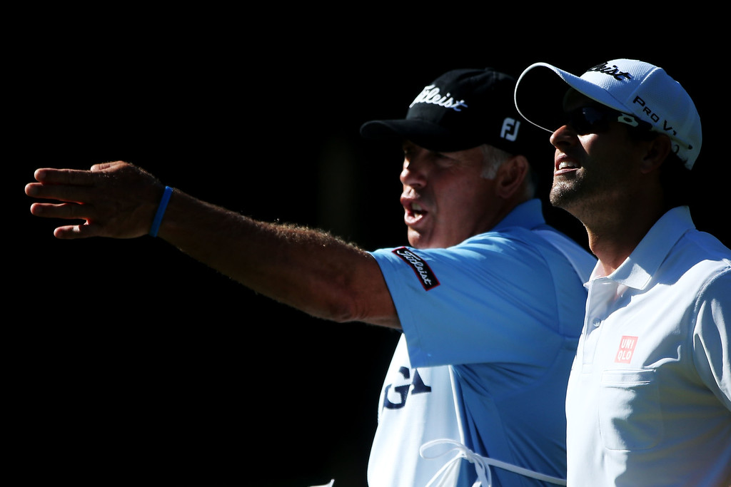 . ROCHESTER, NY - AUGUST 10:  Adam Scott of Australia chats with his caddie Steve Williams on the eighth hole during the third round of the 95th PGA Championship on August 10, 2013 in Rochester, New York.  (Photo by Andrew Redington/Getty Images)