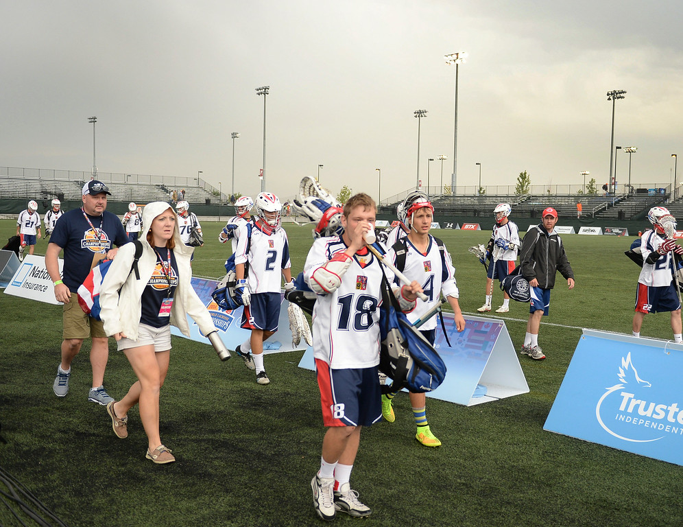. The Czech Republic national team cleared the field after a weather delay was called Tuesday night, July 15, 2014 at the World Lacrosse Championships in Commerce City.   Photo by Karl Gehring/The Denver Post