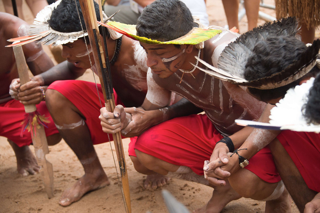 . Brazilian indigenous women of the Kariri Xoco tribe pray before the bow and arrow competition during the XII International Games of Indigenous Peoples in Cuiaba, Mato Grosso state, Brazil on November 12, 2013. AFP PHOTO / Christophe SIMON/AFP/Getty Images