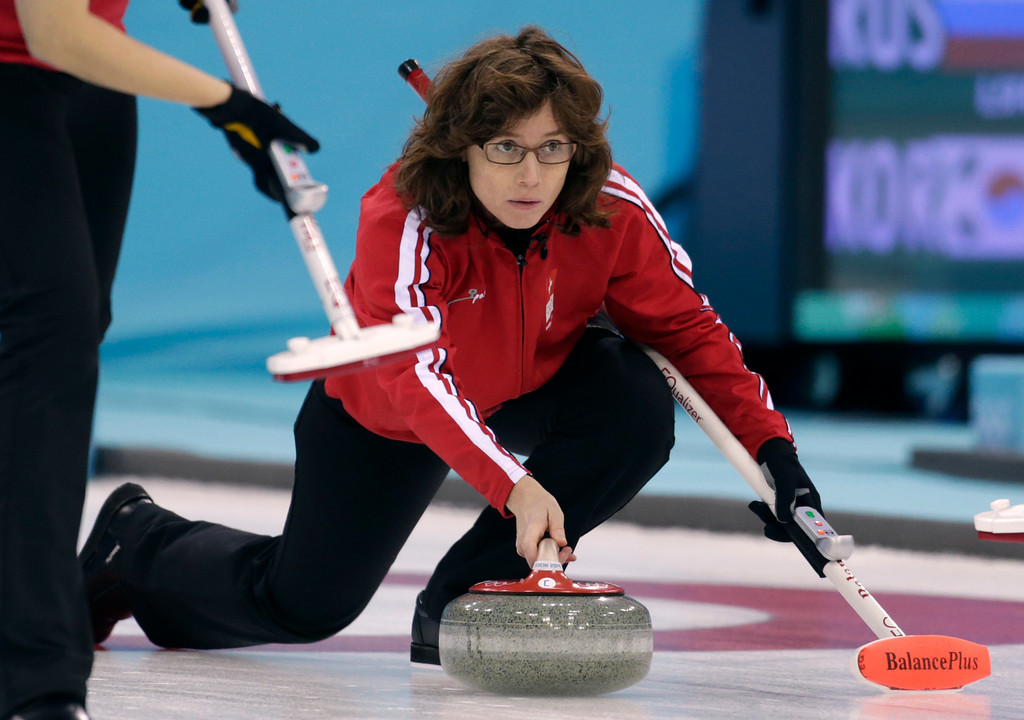 . Switzerland\'s Skip Marjam Ott delivers the rock during women\'s curling competition against Canada at the 2014 Winter Olympics, Thursday, Feb. 13, 2014, in Sochi, Russia. (AP Photo/Robert F. Bukaty)