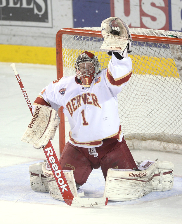 . DENVER, CO. - JANUARY 10: Denver goaltender Sam Brittain made a glove save in the first period. The University of Denver hockey team hosted St. Cloud State at Magness Arena Friday night, January 10, 2014. Photo By Karl Gehring/The Denver Post