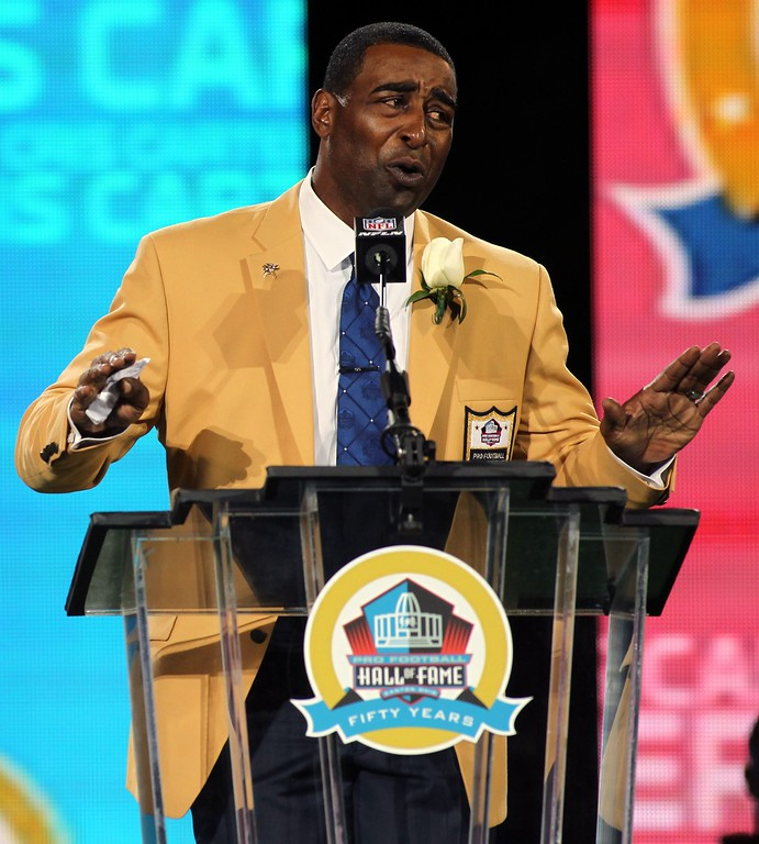 . New inductee Cris Carter talks during his acceptance into the NFL Pro Football Hall of Fame in Canton, Ohio August 3, 2013. REUTERS/Aaron Josefczyk