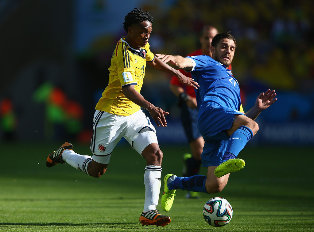 . Juan Guillermo Cuadrado of Colombia and Andreas Samaris of Greece battle for the ball during the 2014 FIFA World Cup Brazil Group C match between Colombia and Greece at Estadio Mineirao on June 14, 2014 in Belo Horizonte, Brazil.  (Photo by Ian Walton/Getty Images)