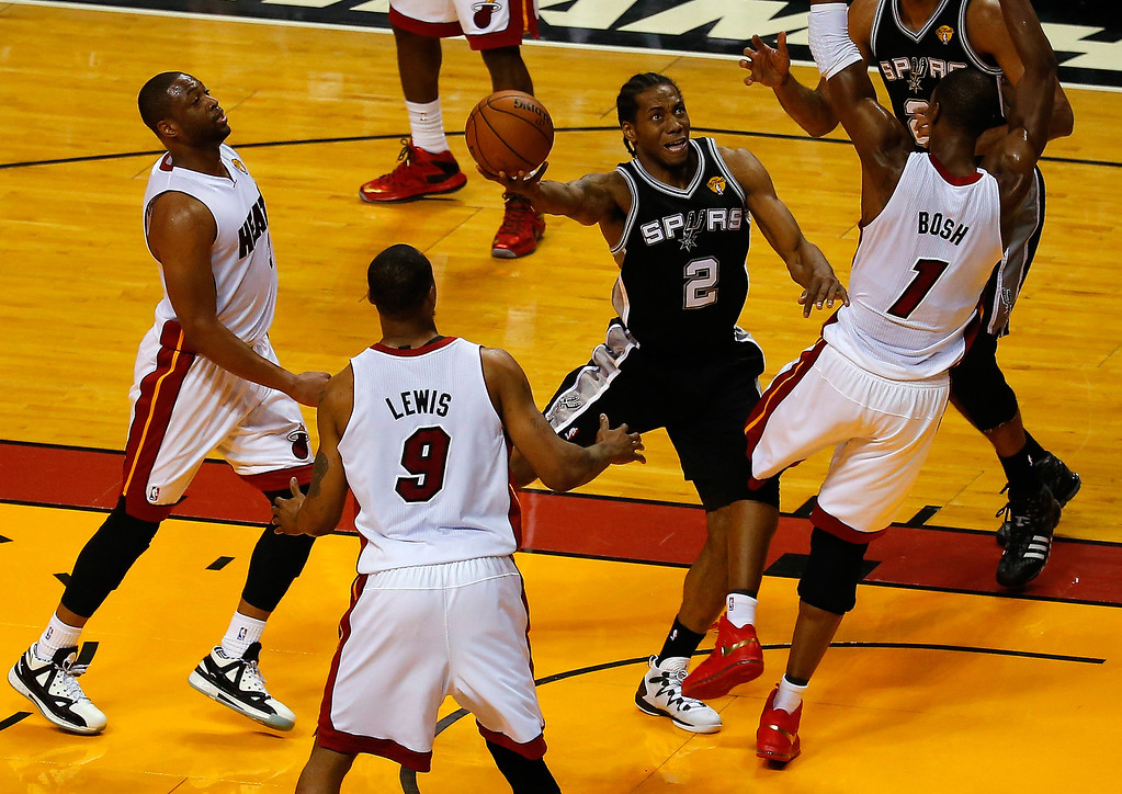 . MIAMI, FL - JUNE 10: Kawhi Leonard #2 of the San Antonio Spurs goes to the basket against Chris Bosh #1 of the Miami Heat during Game Three of the 2014 NBA Finals at American Airlines Arena on June 10, 2014 in Miami, Florida.  (Photo by Chris Trotman/Getty Images)