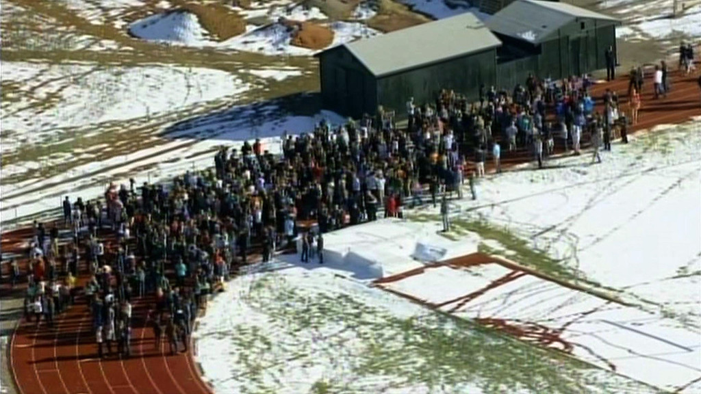 ". In this framegrab taken from video by KCNC television news in Denver, students of Arapahoe High School in Centennial, Colorado gather at a running track on December 13, 2013 after a shooting at the school. Two students were injured in the shooting incident before the suspected gunman apparently killed himself, the local sheriff said. The suspect was also a student. ""That individual is .. deceased, he apparently killed himself,\"" Arapahoe County Sheriff Grayson Robinson told reporters.     AFP PHOTO / KCNC /AFP/Getty Images"